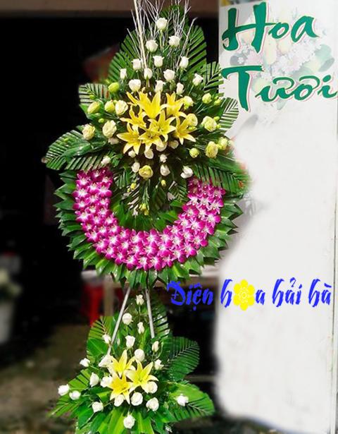 Vòng hoa tang lễ hoa lan tím ly vàng