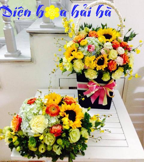 Giỏ hoa hướng dương và lan tường