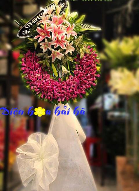 Vòng hoa chia buồn hoa lan mầu đỏ và ly hồng
