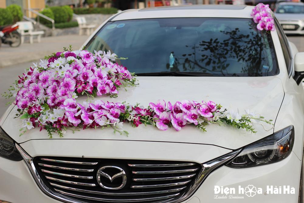 Mua hoa lụa trang trí xe cưới lan hồ điệp tím