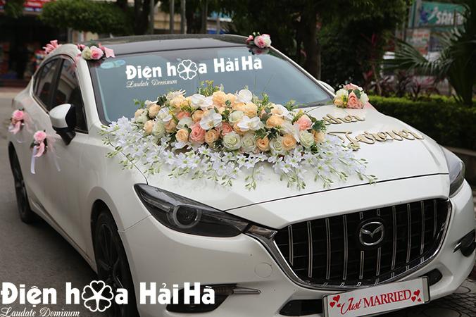 Bộ hoa lụa kết xe cưới hồng mẫu đơn thiết kế mới 2021